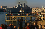Seen off by thousands of the patriotic public, the Royal Navys HMS Ark Royal aircraft carrier leaves Portsmouth docks for active service off Iraq, on 11th January 2003, in Portsmouth, Hampshire, England.
