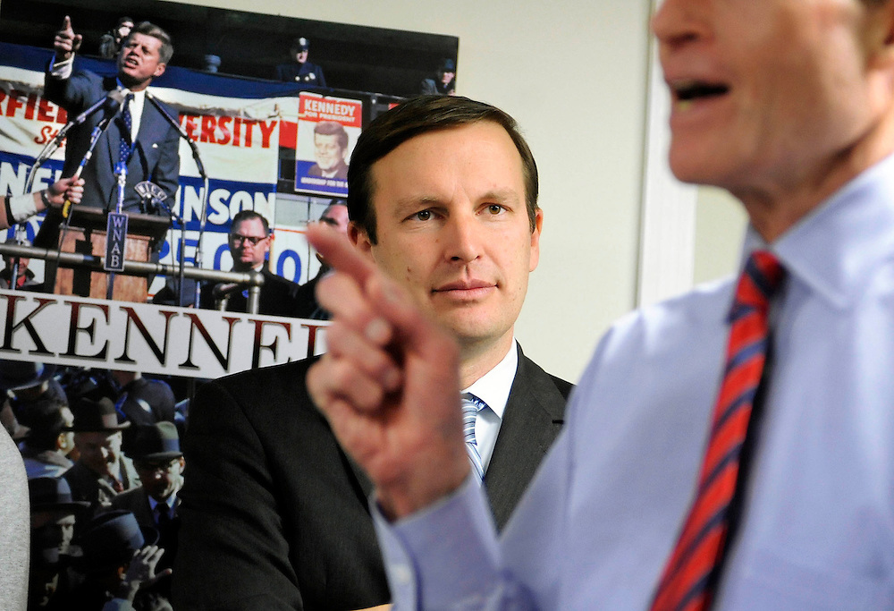 Democratic candidate for U.S. Senate Chris Murphy, center, listens as U.S. Sen. Richard Blumenthal, right, speaks at a rally for volunteers in New Britain, Conn., Sunday, Nov. 4, 2012.  Murphy and Republican opponent Linda McMahon are vying for the Senate seat now held by Joe Lieberman, an independent who's retiring. (AP Photo/Jessica Hill)