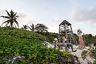 Tulum, Mexico - April 15, 2021: People lift weights at the outdoor beach gym at Playa Las Palmas in Tulum.