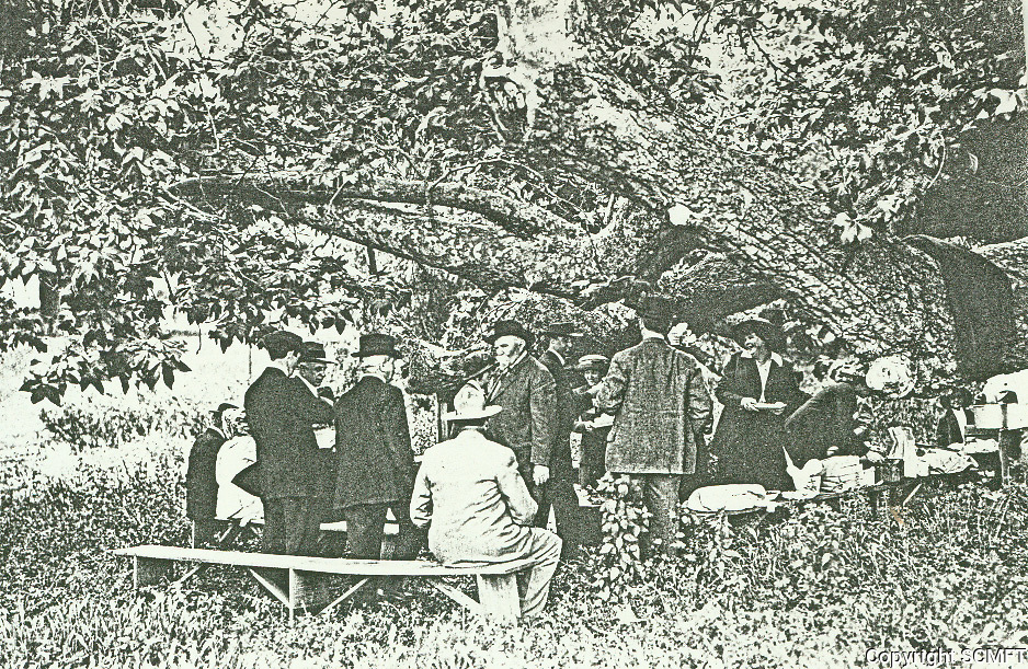 """1909 Gen. Harrison Otis entertains guests under an old Sycamore tree (the hanging tree) on his """"Outpost"""" property. Now the location of Outpost Estates"""