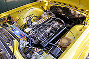 Engine of a 1969/1976 Triumph TR6 (Mimosa Yellow). 2011 Classic Car Show, Whiteman Park, Perth, Western Australia. March 20, 2011