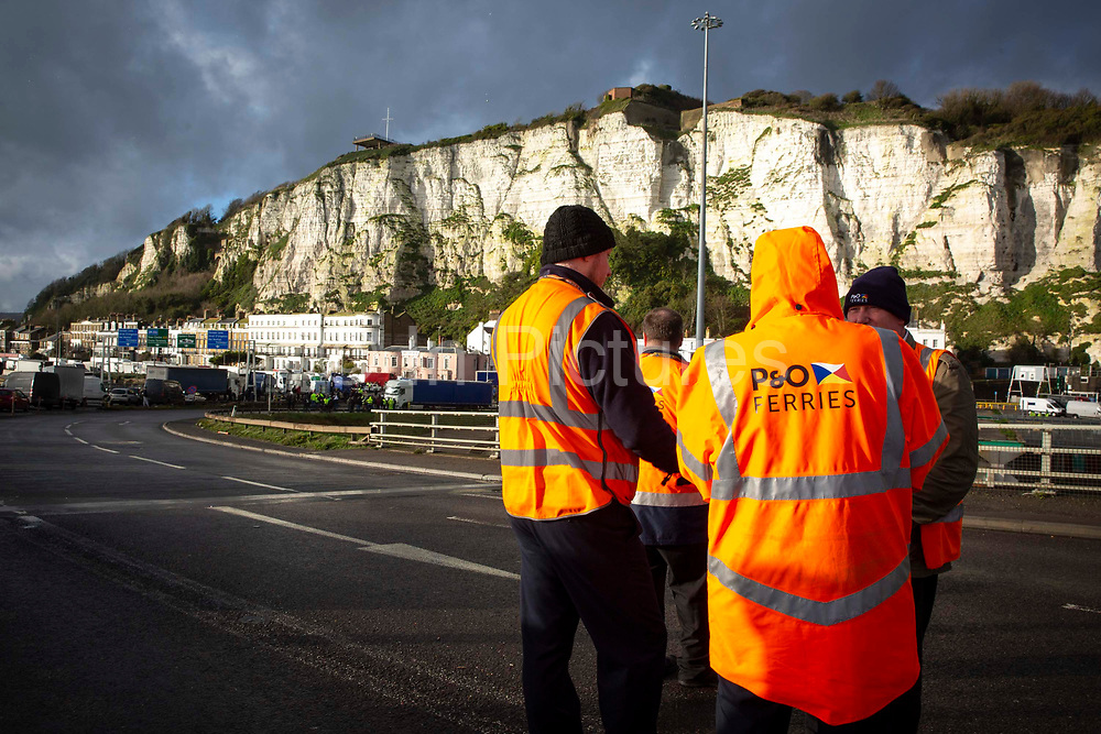 P&O ferry staff wait to access the port as tensions are high between police and drivers who have been waiting over 48 hours for the Port of Dover to re-open, on the 23rd of December 2020, Dover, Kent, United Kingdom. The French border was closed due to a new strain of COVID-19 all travellers are now waiting to receive a COVID-19 test before they can board a ferry to Calais, France. Dover is the nearest port to France with just 34 kilometres 21 miles between them. It is one of the busiest ports in the world. As well as freight container ships it is also the main port for P&O and DFDS Seaways ferries.