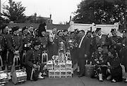 4/7/1964<br /> 7/4/1964<br /> 4 July 1964<br /> <br /> The Bands Pipe Major T.J. Keogh filling the cup after the Carling presentation of Black Label Lager, Included is Mr. Peter McGylnn and Mr. T. Hegarty the Sales Supervisor from Carling.