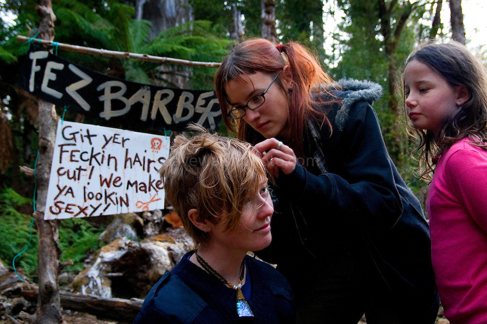 Greta, from Melbourne, gets a haircut at the Upper Florentine forest Party.....Activists are  blocking a forest access road made by contractors for Forestry Tasmania, in order to stop the logging of old growth forest in what is potentially a World Heritage Area.