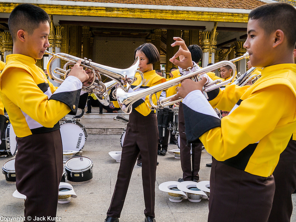 05 DECEMBER 2012 - BANGKOK, THAILAND:  A Bangkok high school marching band tunes up before the parade during the public ceremony to celebrate the birthday of Bhumibol Adulyadej, the King of Thailand, on Sanam Luang, a vast public space in front of the Grand Palace in Bangkok Wednesday night. The King celebrated his 85th birthday Wednesday and hundreds of thousands of Thais attended the day long celebration around the Grand Palace and the Royal Plaza, north of the Palace. The Thai monarch is revered by most Thais as unifying force in Thailand's society, which is not yet recovered from the political violence of 2010.     PHOTO BY JACK KURTZ