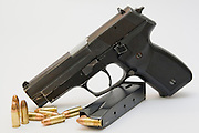A Czech CZ-99 9mm parabelum semi-automatic hand gun bullets and cartridge Cut out on white background