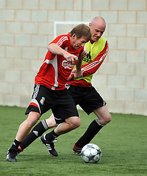 LIVERPOOL, ENGLAND - Tuesday, May 12, 2009: Ex-Liverpool player and manager Kenny Dalglish and Liverpool Echo reporter Tony Barrett during a training session at Melwood as the players prepare for the Hillsborough Memorial Game in aid of the Marina Dalglish Appeal which will be staged at Anfield on May 14. (Photo by Dave Kendall/Propaganda)