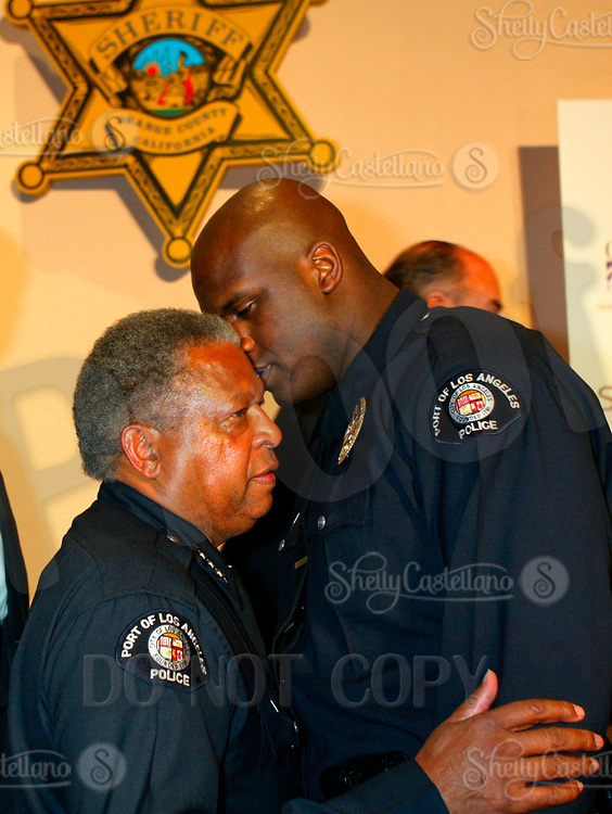 Apr 05, 2003; Anaheim, CA, USA; NBA Basketball superstar SHAQUILLE O'NEAL of the Los Angeles Lakers is currently a level 2 Police Officer for the LA Port Authority. SHAQ recieved the Gold Star Celebrity Leadership Award @ the 2nd Annual California Gold Star Gala @ the Disneyland Hotel. This is his first time in public wearing his custom sized uniform. Talking with LA Port Authority Chief of Police NOEL K. CUNNINGHAM. <br />Mandatory Credit: Photo by Shelly Castellano/ZUMA Press.<br />(©) Copyright 2003 by Shelly Castellano