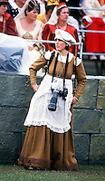 British photographer Jayne Fincher seen in costume on the set of the 'Grand Royal Knockout Tournament'  at Alton Towers, UK in July 1987.