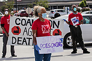 Lydia Gerard with the  Concerned Citizens of St. John at a protest  calling for the Govonor to shut down petrochemical plants in St. James and St. John the Baptist Parish where African Americans exsposed to pollution are dying at fast rate from COVID-19, on April 11, 2020 in front of the St. John the Baptist Government Building in LaPlace.Louisana