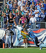 Nov 2, 2008, Nashville, Tennessee, USA;  Jermichael Finley(88) of the Green Bay Packers goes airborne for a pass against Josh Stamer(57) of the Tennessee Titans at LP Field as the Packers are defeated by the Titans 19-16.
