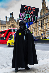 """The Grim Reaper stands alone outside the Houses of Parliament in London demanding """"Stop Brexit"""" as MPs debate and later vote on whether to accept Prime Minister Theresa May's Brexit deal. London, January 15 2019."""