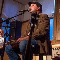082313       Cable Hoover<br /> <br /> Mark Schwerdt and his son Finn Schwerdt welcome a crowd to the opening of the Old Train Music and Arts center in Gallup Friday.