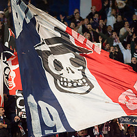 8 March 2007: Supporters of the french soccer team Paris Saint-Germain (PSG) Football Club hold banners of their group called Kop of Boulogne in the Boulogne stands prior to the UEFA Cup eighth-finals First Leg soccer game won 2-1 by PSG FC over SL Benfica at the Parc des Princes stadium, in Paris, France.