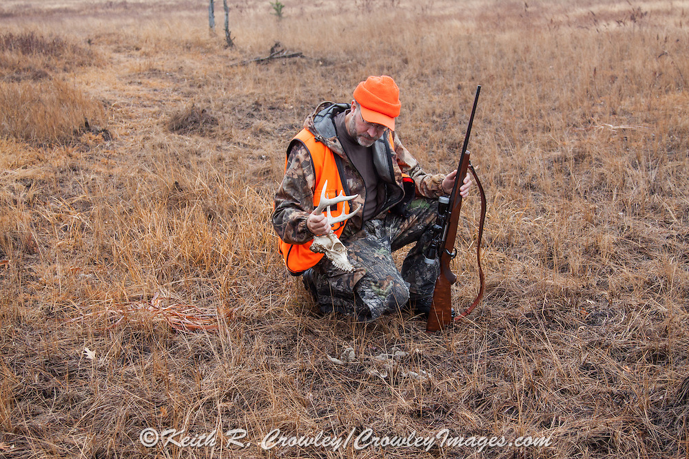 A Wisconsin Hunter Examines the Site of a Wolf Kill.