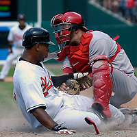 01 July 2007:   Baltimore Orioles third baseman Melvin Mora (L) attempts to score in the bottom of the 9th inning on a fly ball off the bat of second baseman Brian Roberts against Los Angeles Angels pitcher Francisco Rodriguez. Mora was thrown out at home by right fielder Vladimir Guerrero as catcher Mike Napoli (R) applies the tag to end the game as the Angels defeated the Orioles 4-3 at Camden Yards in Baltimore, MD.   ****For Editorial Use Only****