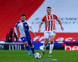 James Chester of Stoke City brings the ball into midfield, pursued by Adam Armstrong of Blackburn Rovers - Mandatory by-line: Nick Browning/JMP - 19/12/2020 - FOOTBALL - Bet365 Stadium - Stoke-on-Trent, England - Stoke City v Blackburn Rovers - Sky Bet Championship