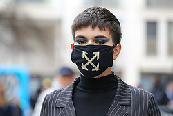 © Licensed to London News Pictures. 14/02/2020. London, UK. A fashion enthusiast wearing a fashionable face mask arrives for the London Fashion Week shows in The Strand. The latest Coronavirus patient in London is linked to 'super spreader'attended transport conference with 250 people in Westminster. Photo credit: Dinendra Haria/LNP