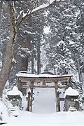 Scenic winter landscape with covered in snow entrance, Nagano, Japan