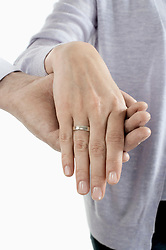 Mid section view of man holding hand of woman, Bavaria, Germany