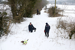 © Licensed to London News Pictures. 3/03/2018. Bodden, UK. People look at a snow drift blocked road at Bodden near Shepton Mallet, Somerset after a week of heavy snow.Photo credit: Jason Bryant/LNP