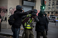 A protester held in custody by the police after some clashes. More than 125000 gathered in Paris for the Gilets Jaune (Yellow vest) protest. Soon the protest turned violent an protesters clashed with the police, tear gas and flash bombs were fired, many injured and arrested by the police. Paris December 6th 2018. Federico Scoppa