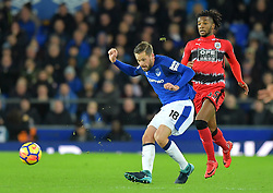 """Everton's Gylfi Sigurdsson (left) and Huddersfield Town's Kasey Palmer in action during the Premier League match at Goodison Park, Liverpool. PRESS ASSOCIATION Photo Picture date: Saturday December 2, 2017. See PA story SOCCER Everton. Photo credit should read: Dave Howarth/PA Wire. RESTRICTIONS: EDITORIAL USE ONLY No use with unauthorised audio, video, data, fixture lists, club/league logos or """"live"""" services. Online in-match use limited to 75 images, no video emulation. No use in betting, games or single club/league/player publications."""