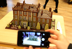 People take a picture of cake of Highgrove House gifted by Prince Charles (known as The Duke of Rothesay when in Scotland) during his visit to the Ayrshire Hospice in Ayr where he met patients and their families, staff and volunteers.