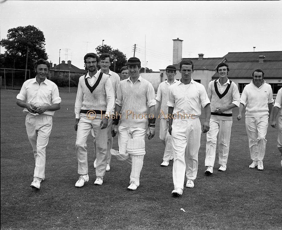 18/07/1970<br /> 07/18/1970<br /> 18 July 1970<br /> Cricket: Clontarf 1st XI v Old Belvedere, Leinster Senior Cup Final at Clontarf Cricket Club, Dublin. The Clontarf team led by their captain, Fergus Carroll (centre), take the field. The final was sponsored by Player-Wills and continued on the Sunday.