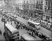 17/03/1960<br /> 03/17/1960<br /> 17 March 1960<br /> NAIDA Industrial St. Patrick's Day Parade, Dublin. Picture shows Smithwicks floats, on Leyland trucks, on Westmoreland street followed by a Taylor Keith Soft Drinks display.