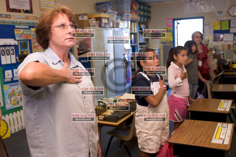 Teacher Annelle Reynolds, (L) leads her class, including Fourth grade student Alisia Matute, Yessica Godnez and Guadalupe  Avalos and Para-Professional,  Chris Carroll,  in reciting the Pledge of Allegiance at Fairview Elementary School, in Modesto, Calif.  Fairview is one of the 16 First Amendment Schools, sponsored by the non-partisan First Amendment Center ,  in the nation.  Photo by Kim Kulish