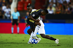 September 19, 2018 - Valencia, Spain - Alex Sandro, Michy Batshuayi (L) battle for the ball during the Group H match of the UEFA Champions League between Valencia CF and Juventus at Mestalla Stadium on September 19, 2018 in Valencia, Spain. (Credit Image: © Jose Breton/NurPhoto/ZUMA Press)