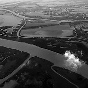 """An aerial view of the complex and fragile coastal boundaries of Lousiana. The Gulf Coast is made up of a delicate mix of bayous, marshes, rivers and sea, all of which are threatened from the Deepwater Horizon Oil Spill. ltqmb """"Fragile Boundaries"""""""