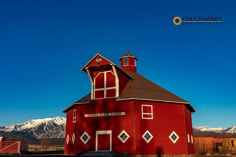 Triple Creek Ranch Octagonal Barn built in 1906 with Wallowa Mountains in Joseph, Oregon, USA