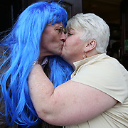 Dave Dickson (left) and Marian Watt celebrate with a kiss outside the Royal Bar.  Fans celebrate as St Johnstone win the Scottish Cup. Regulars at the Royal Bar in Perth are over the moon after St Johnstone beat Dundee United 2-0 in the final at Celtic Park, Glasgow. Picture Robert Perry 17th May 2014<br /> <br /> Must credit photo to Robert Perry<br /> FEE PAYABLE FOR REPRO USE<br /> FEE PAYABLE FOR ALL INTERNET USE<br /> www.robertperry.co.uk<br /> NB -This image is not to be distributed without the prior consent of the copyright holder.<br /> in using this image you agree to abide by terms and conditions as stated in this caption.<br /> All monies payable to Robert Perry<br /> <br /> (PLEASE DO NOT REMOVE THIS CAPTION)<br /> This image is intended for Editorial use (e.g. news). Any commercial or promotional use requires additional clearance. <br /> Copyright 2014 All rights protected.<br /> first use only<br /> contact details<br /> Robert Perry     <br /> 07702 631 477<br /> robertperryphotos@gmail.com<br /> no internet usage without prior consent.         <br /> Robert Perry reserves the right to pursue unauthorised use of this image . If you violate my intellectual property you may be liable for  damages, loss of income, and profits you derive from the use of this image.