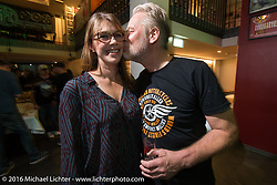 Andreas Scholz with his wife at the Custom Chrome Europe evening party in the old town after a long day at the Intermot Motorcycle Trade Fair. Cologne, Germany. Friday October 7, 2016. Photography ©2016 Michael Lichter.