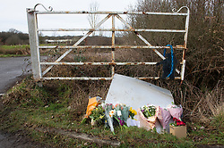 © Licensed to London News Pictures 12/03/2021. Ashford, UK. Flowers at the main gate.  Teams of Metropolitan police officers continue to search Great Chart Leisure in Ashford, Kent today in connection with the ongoing investigation into the disappearance of Sarah Everard from London. Photo credit:Grant Falvey/LNP