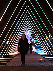 © Licensed to London News Pictures. 17/01/2018. London, UK. People walk thorough an installation entitled 'OSC-L ?by Ulf Langheinrich' at the Lumiere London festival. Running from 18th-21st January 2018 more than 50 artworks? are transforming the capital's streets, buildings and public spaces into an immersive nocturnal art exhibition of light and sound. Locations include King's Cross, Fitzrovia, Mayfair, West End, Trafalgar Square, Westminster, Victoria, South Bank and Waterloo. Photo credit: Peter Macdiarmid/LNP