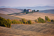 Typical Tuscan homestead and landscape near Montalcino, Val D'Orcia, Tuscany, Italy