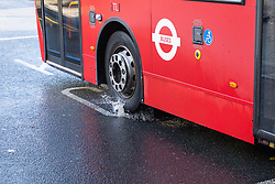 A bus splashes through a sunken drain 'pothole' on Station road, pointed out by an off duty bus driver, that could have been a contributing factor to Sunday's bus crash in which 19 people were injured including a teenage girl who is in critical condition. The bus driver was arrested on suspicion of drug driving. Croydon, South London November 12 2018.