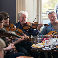 Musicians playing a lunchtime session in the Rowan Tree