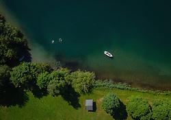 THEMENBILD - Menschen schimmen neben einem Boot am Zeller See in Ufernähe, aufgenommen am 30. Juni 2019 in Zell am See, Österreich // People swimming next to a boat at the Zeller lake near the shore, Zell am See, Austria on 2019/06/30. EXPA Pictures © 2019, PhotoCredit: EXPA/ JFK