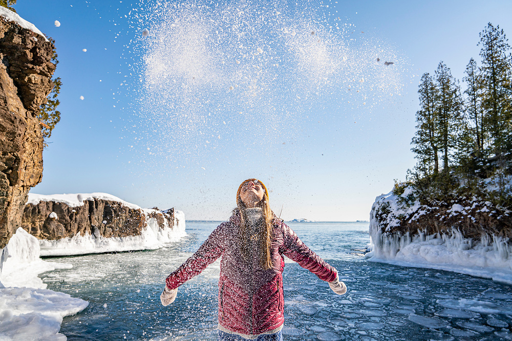 Hiking with friends at Presque Isle Park in Marquette, Michigan in winter.