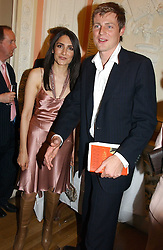 ZAC GOLDSMITH and RENU MEHTA at a party to celebrate the publication of Andrew Robert's new book 'Waterloo: Napoleon's Last Gamble' and the launch of the paperback version of Leonie Fried's book 'Catherine de Medici' held at the English-Speaking Union, Dartmouth House, 37 Charles Street, London W1 on 8th February 2005.<br /><br />NON EXCLUSIVE - WORLD RIGHTS