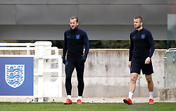 England's Harry Kane (left) and Eric Dier during the training session at St George's Park, Burton.