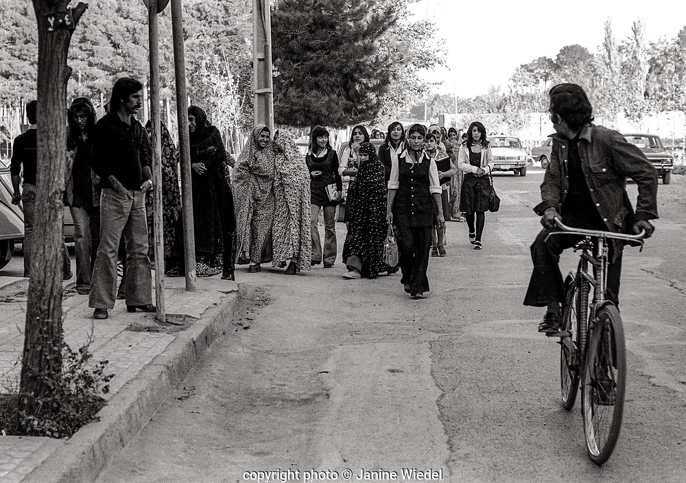 Young women on way home from school in Streets of Tehran Iran 1970s