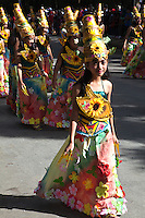 """Filipina Schoolkids Parade at Panagbenga - The Baguio Flower Festival a month long extravaganza that takes place in Baguio during February.  The term means """"season of blooming"""" and the festival was created as a tribute to flowers. The festival includes street dancing, presented by dancers dressed in colorful floral costumes."""