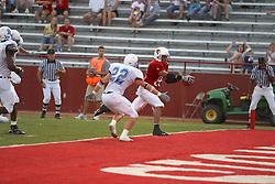 10 Sep 2005<br /> <br /> Jason Horton extends the ball past the plane of the goal leaving Jace Denison helpless to prevent the score.<br /> <br /> Illinois State University V Drake.  Hancock Stadium, Illinois State University, Normal IL