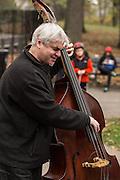 Bassist Ken Filiano backs up Jason Kao Hwang at Jazz and Colors in Central Park.