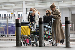 © Licensed to London News Pictures.  30/07/2021. London, UK. Passengers arrive at the Heathrow Airport in West London. Covid vaccine passports have been launched in England yesterday thus passengers can use it as a proof for foreign travel. Also, double jabbed travellers arriving in Britain from the EU and US will be allowed to skip isolation.  Photo credit: Marcin Nowak/LNP